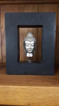Buddha in a shelf