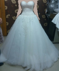 wedding dress for 7500 AED oreginal price 14500 AED