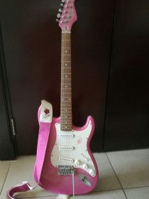 NEW Pink electrical guitar and amplifier