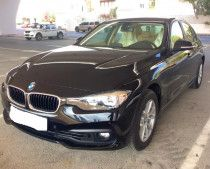 BRAND NEW BMW 318I BLACK 2016 WITH 2 YEARS INTERNATIONAL WARRANTY 100KM ONLY....