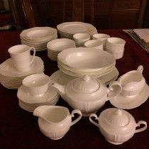 Attractive creamy white dinner and tea set