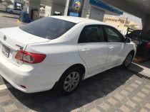 Toyota corolla 2011 white urgent sale in Dxb Silicon Oasis