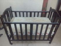 Baby Cot Ideal for a 1-3yr old, mattresses included.