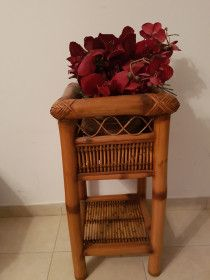 solid wood stand with flower arrangement