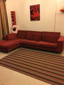 Good condition red Sofa and amazing coffee table
