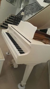 White SAMICK Grand Piano for only Aed 24,000.