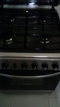 very clean 4 heads gas cooker to go within max 2 days