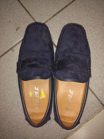 Blue slip-on size 40 and was used few times for sale in Dubai