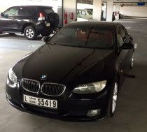 BMW 325i - Hardtop - 2009 - Black exterior - Red interior for sale in Dubai