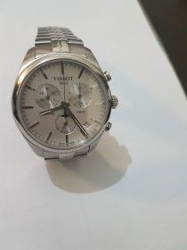 BRANDED WRIST WATCH, TISSOT. IN A PERFECT CONDITION. HAVING WARRANTY CARD.