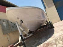 27 Feet Fiber Boat with a Galvanized double axel trailer for Urgent Sale