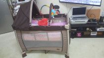 For sale giggles crib/travel cot with mattress