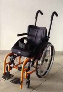 """""""TI LITE"""" Wheelchair for a disabled child"""