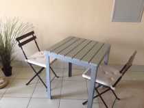 Table and 2 chairs with comfortable coussins