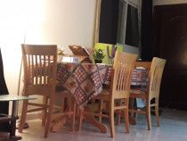 very strong wooden dining table with 6 chears