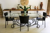 Glass Dining Room Table with Hand-made iron base. Price Reduced by AED 1,000!